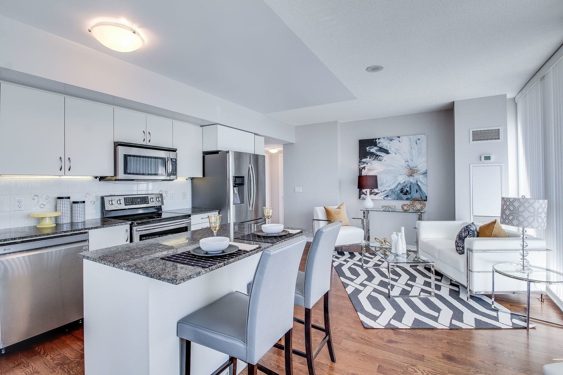 Inside of Condo white with granite kitchen top and small but classy living room space